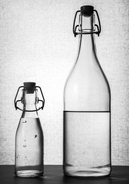 2 bottles of water packaged with glass bottles